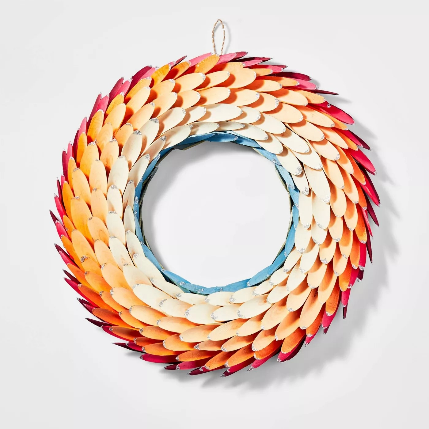 The wreath with red, orange, yellow and blue feathers arranged in circular rows