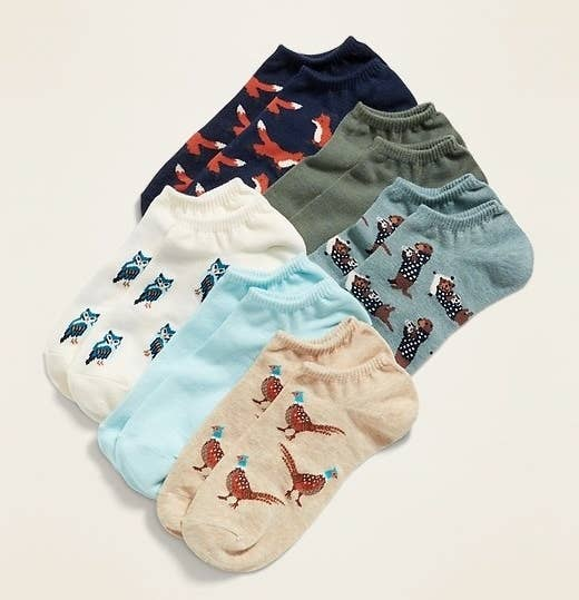 A set of six pairs of socks featuring a variety of colors and cute critters