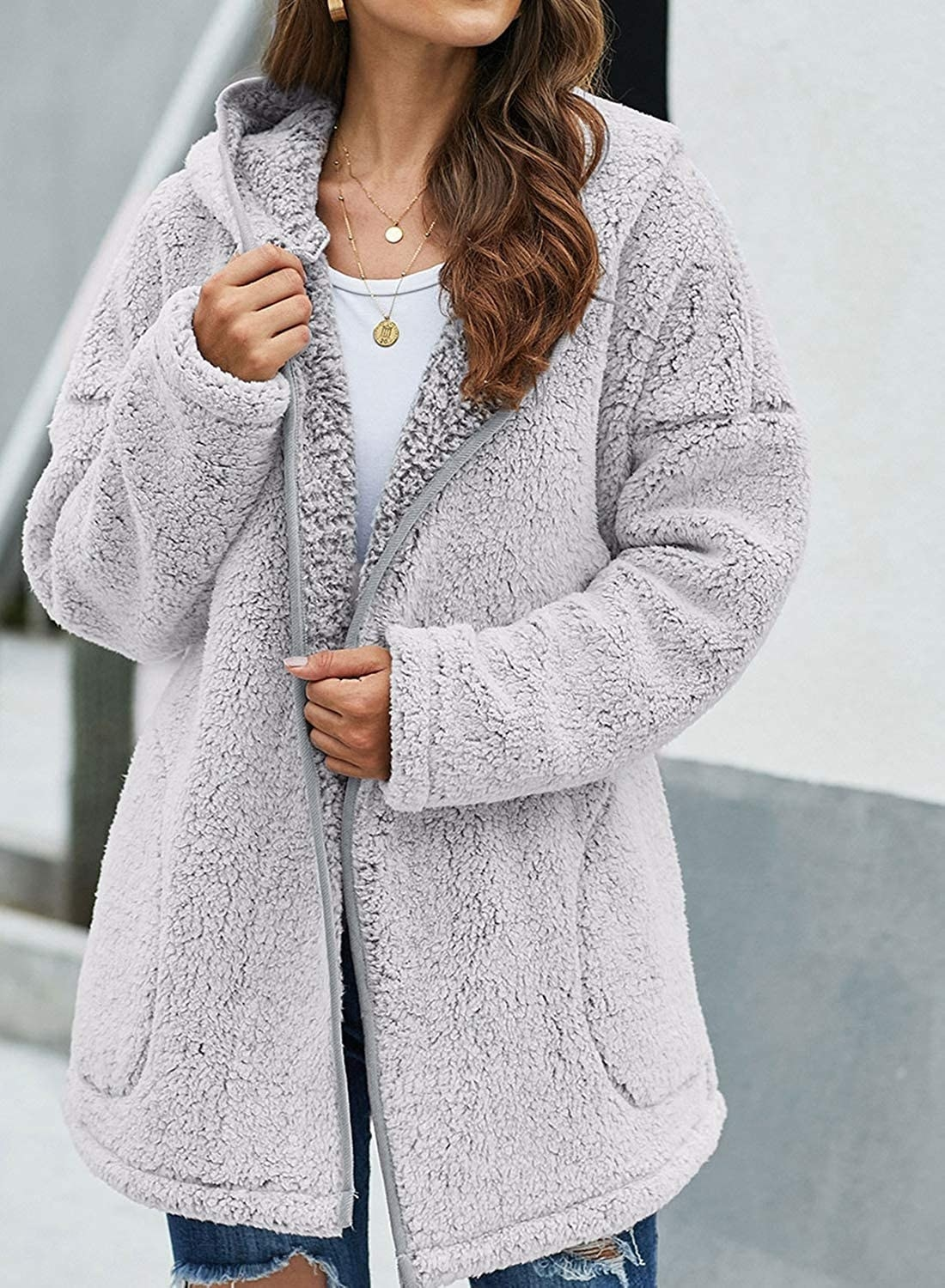 A close up of a model in the Dokotoo Fuzzy Fleece Open Front Hooded Cardigan in gray