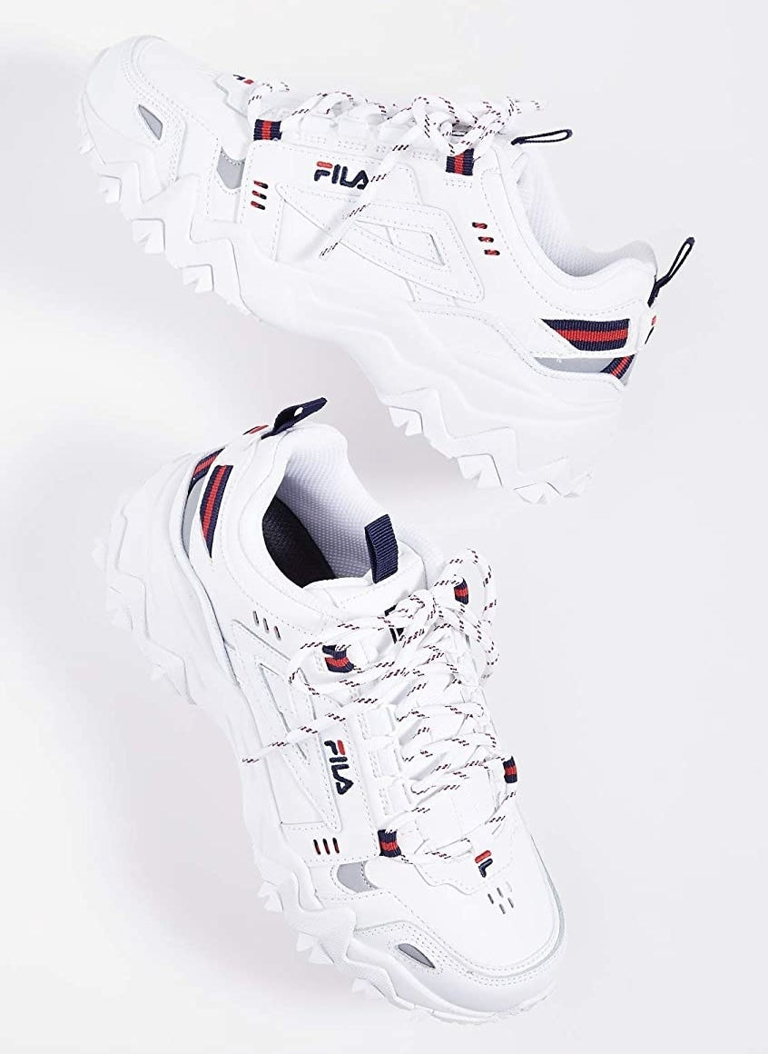 White Fila chunky sneakers with red and blue accents