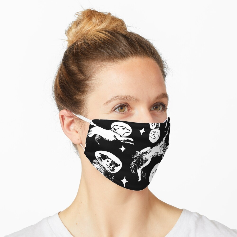 model wears black mask with white astronaut dogs on it