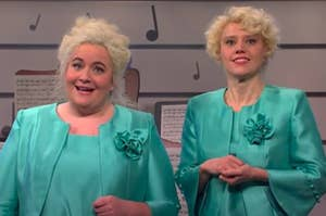 Aidy Bryant and Kate McKinnon dressed as elderly show choir directors