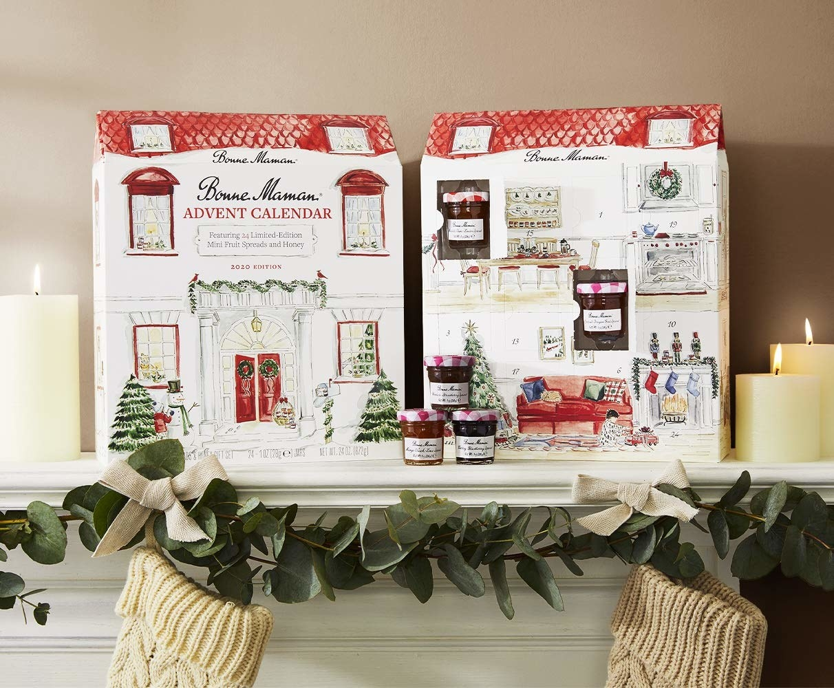 a beautiful advent calendar designed to look like a house filled with mini jams and honey