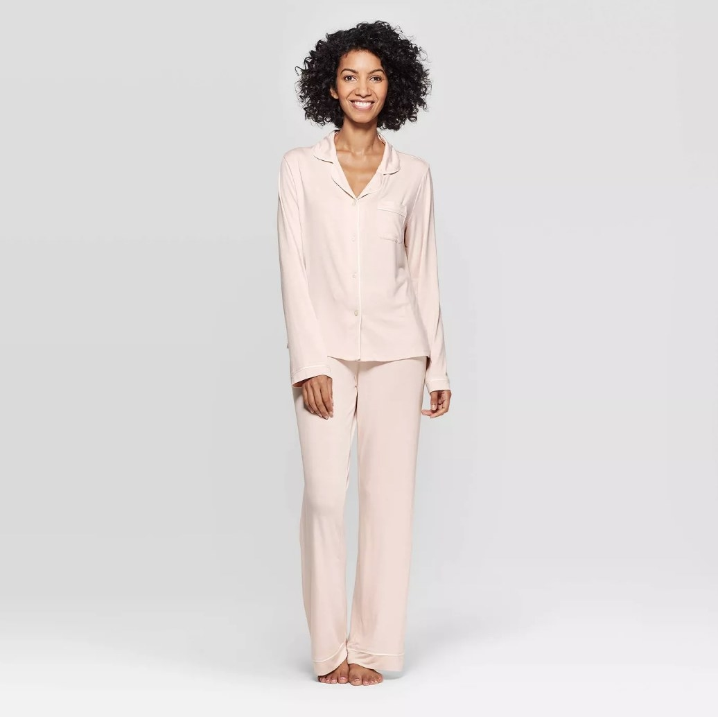 Model wearing pink long sleeve button down pajama set