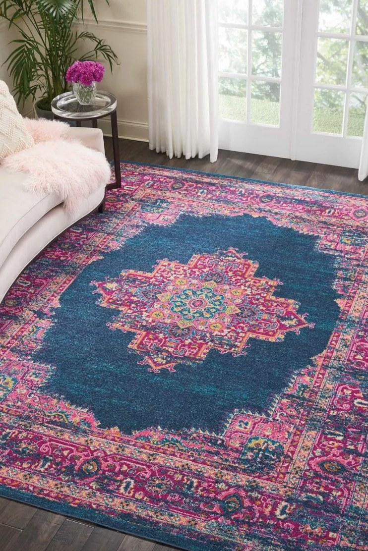 The navy and pink rug