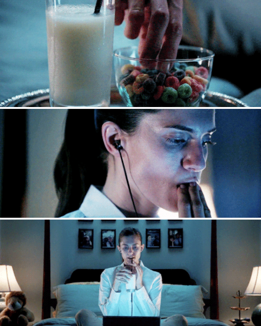 Rose eating milk and cereal separately in bed while watching something on her laptop