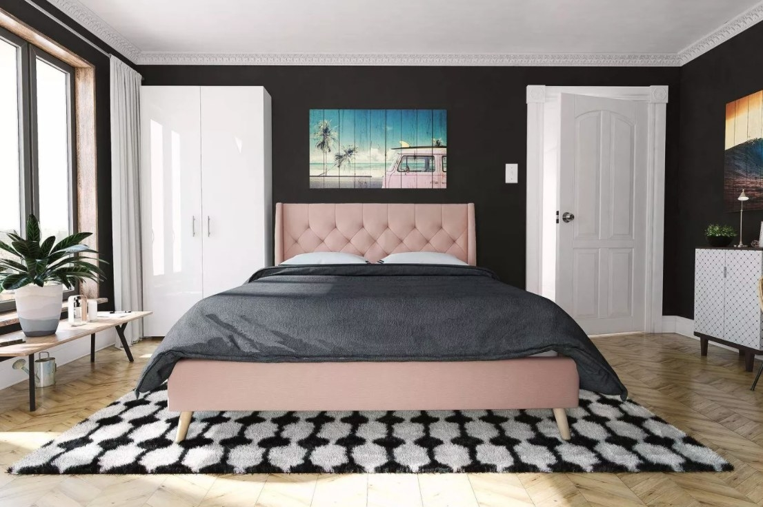 The pink tufted bed