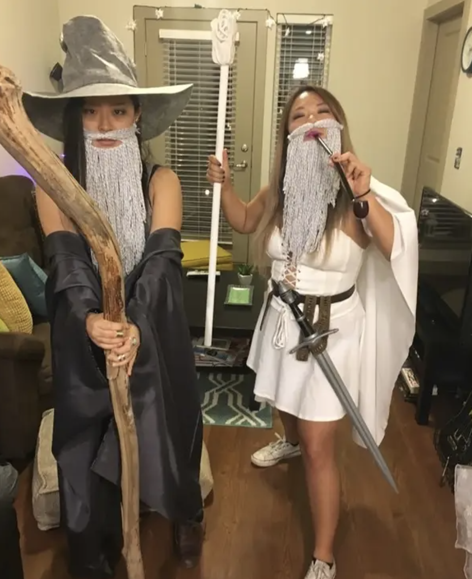 Two woman dressed as scantily-clad Gandalfs