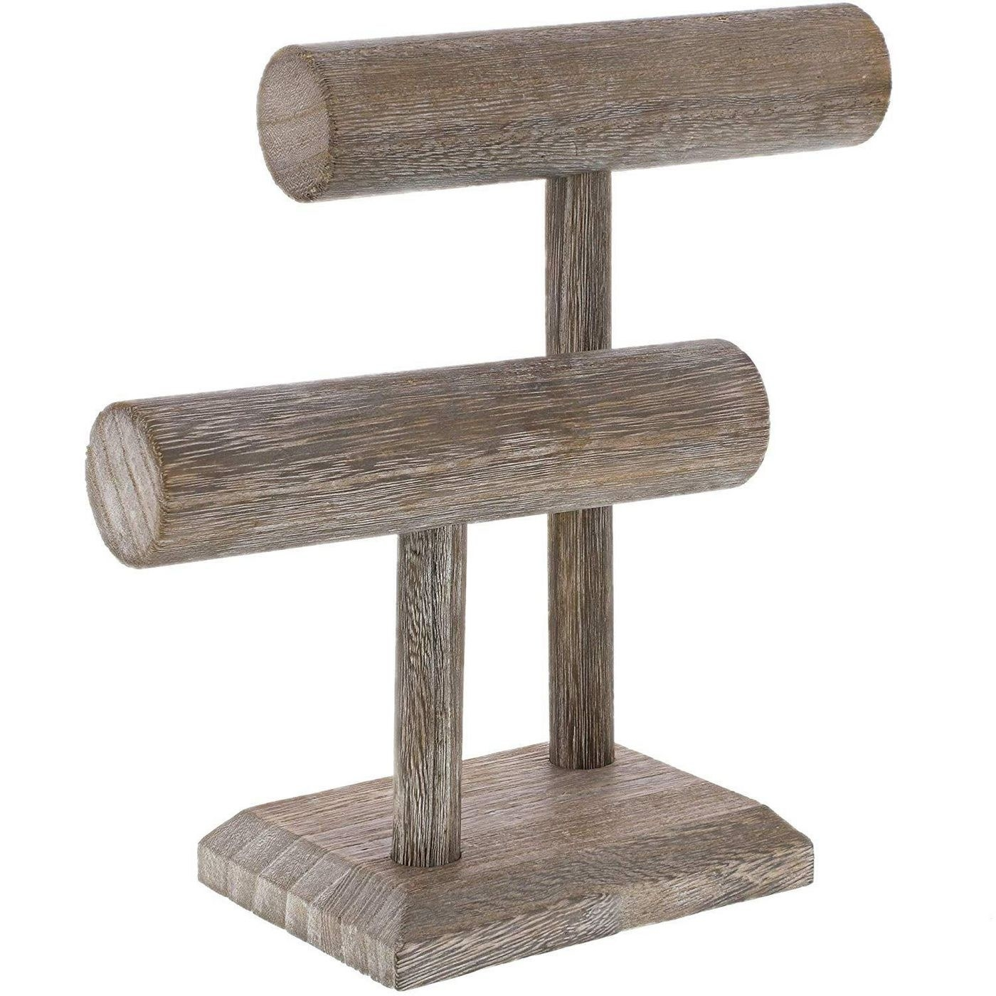 The stand, which has a rectangular base, two slim vertical poles and, hanging from them, two thick horizontal poles