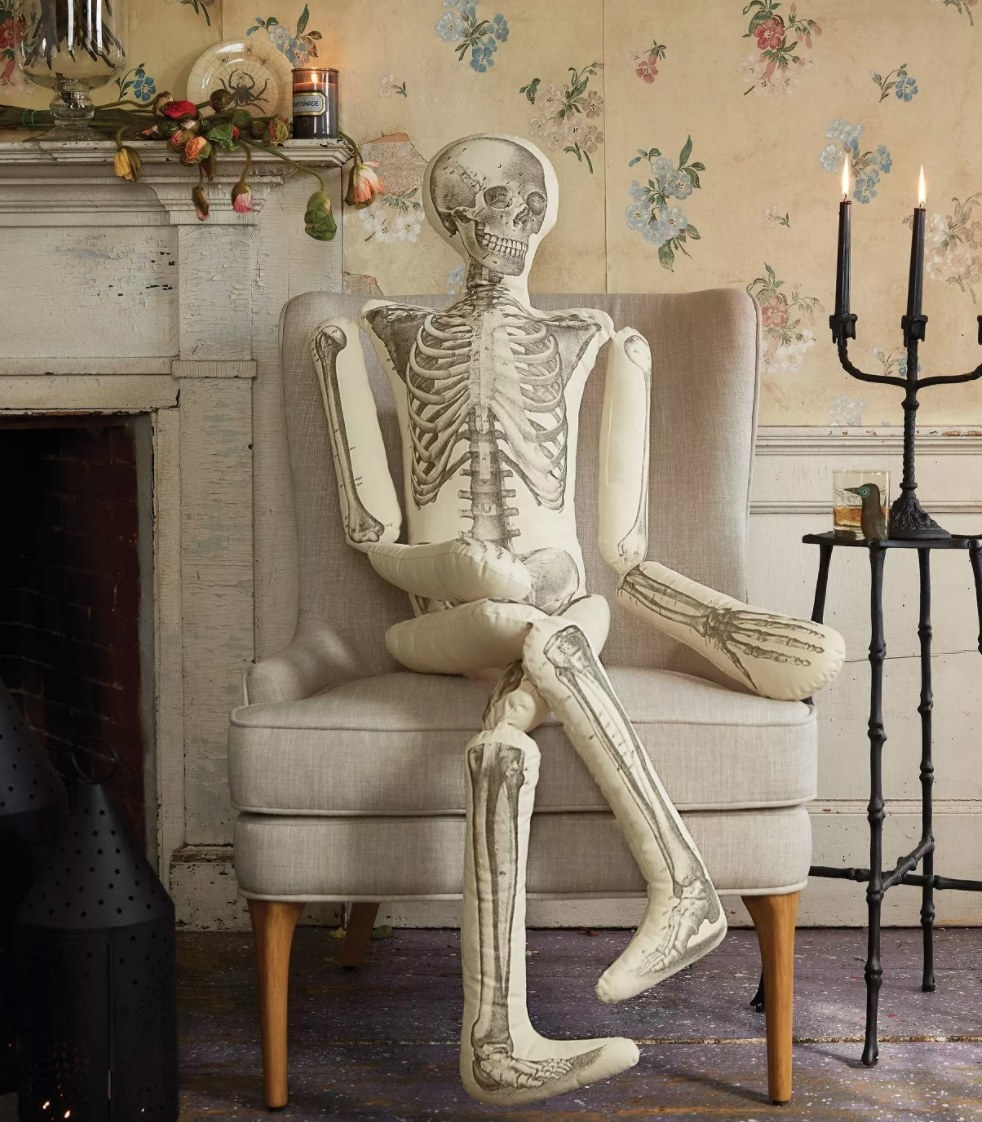 The white and bone-colored skeleton pillow