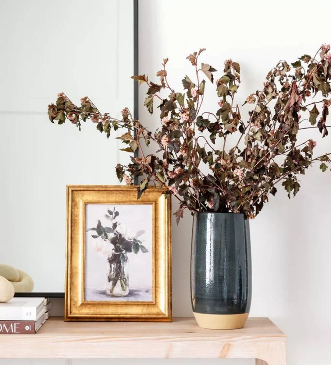 The vase with flowers on an entryway table