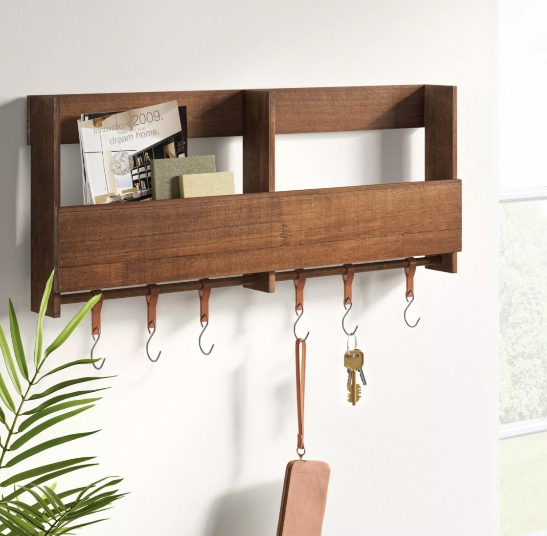 The brown wood entryway wall organizer