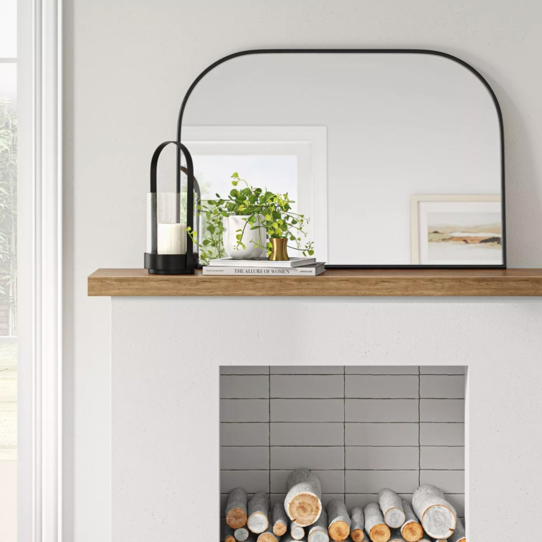 The arched mirror with a black frame
