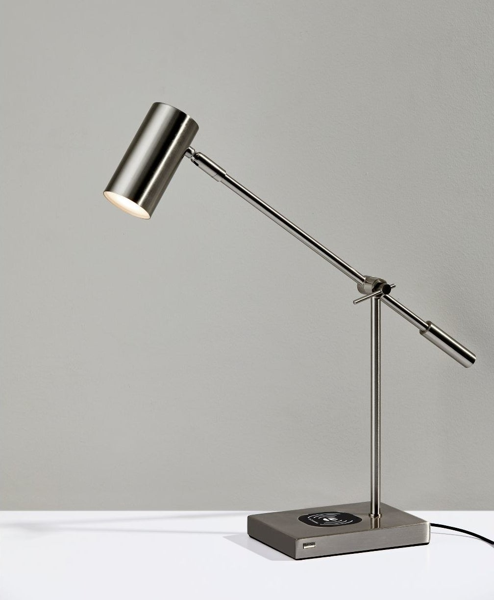 The lamp, which has an adjustable cylindrical head, an adjustable stick body, and a rectangular base with the charging station