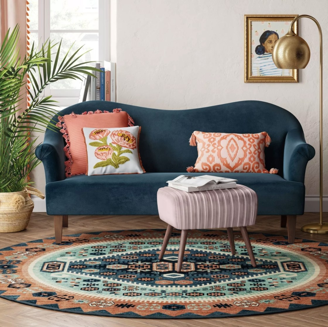 The teal, navy, and coral circular area rug