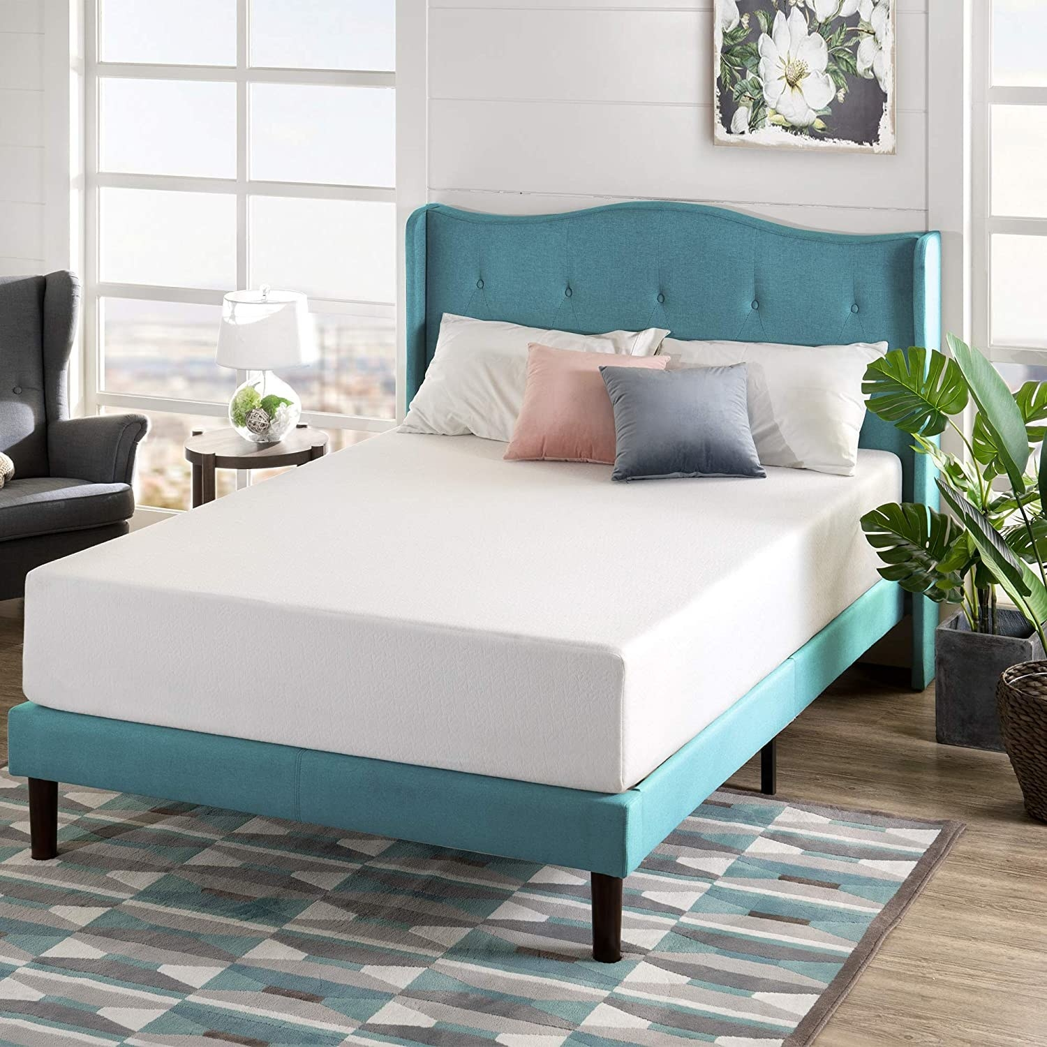 A mattress on a bedframe with pillows on top