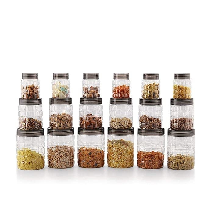 18 clear plastic jars in three different sizes.
