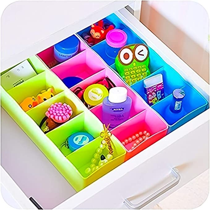 Green, pink and blue drawer organisers.