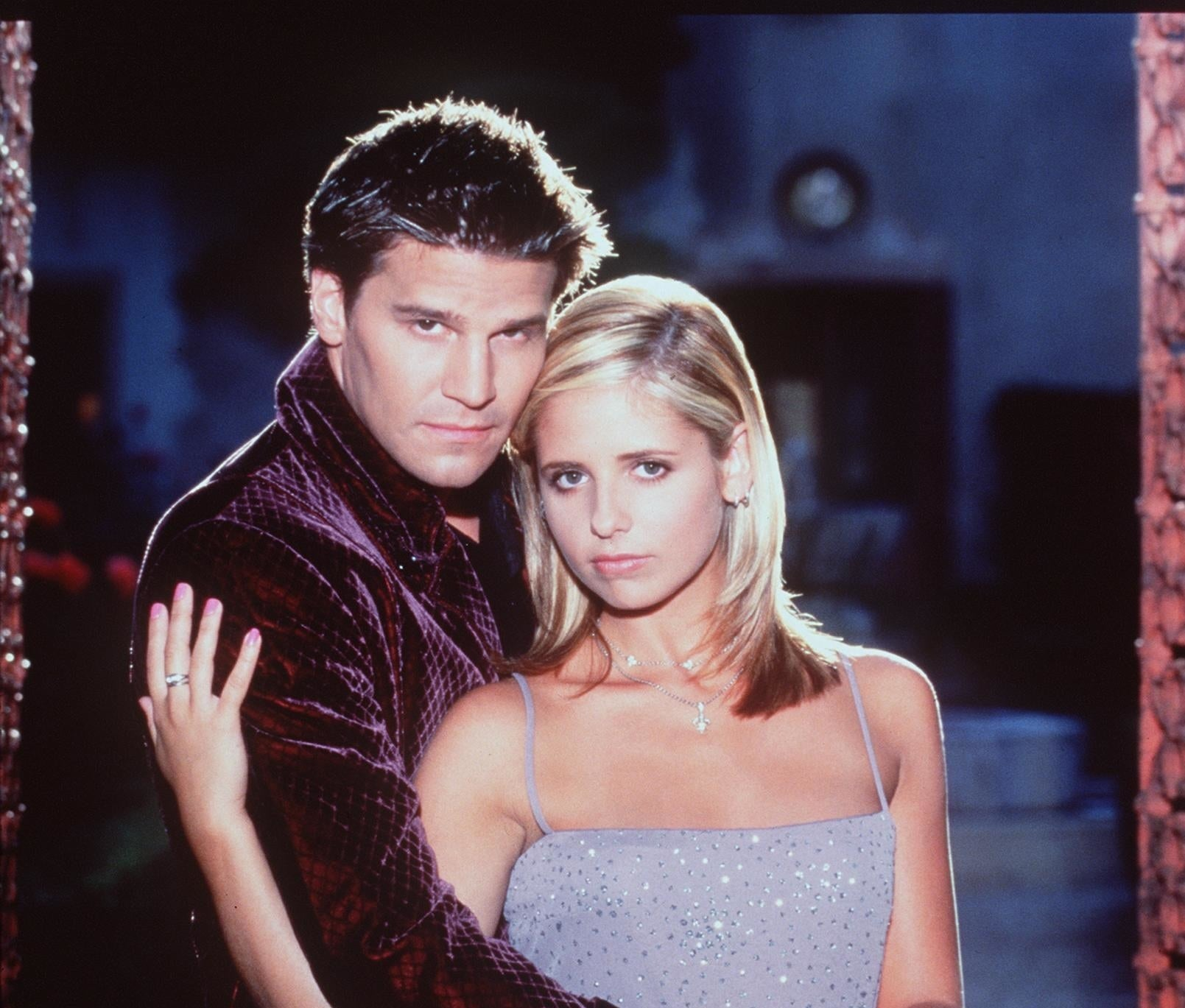 A publicity photo of Angel and Buffy hugging