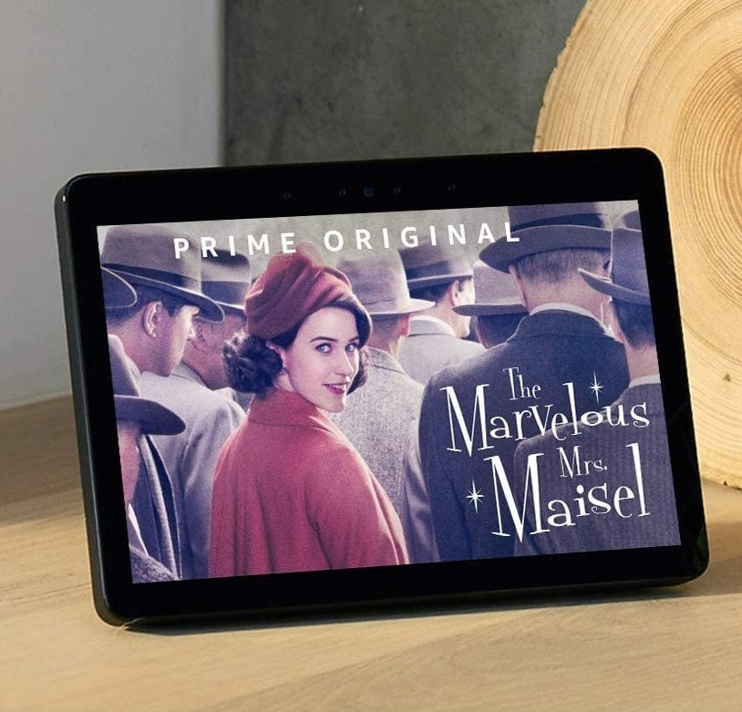 A person watching a show on the Echo Show