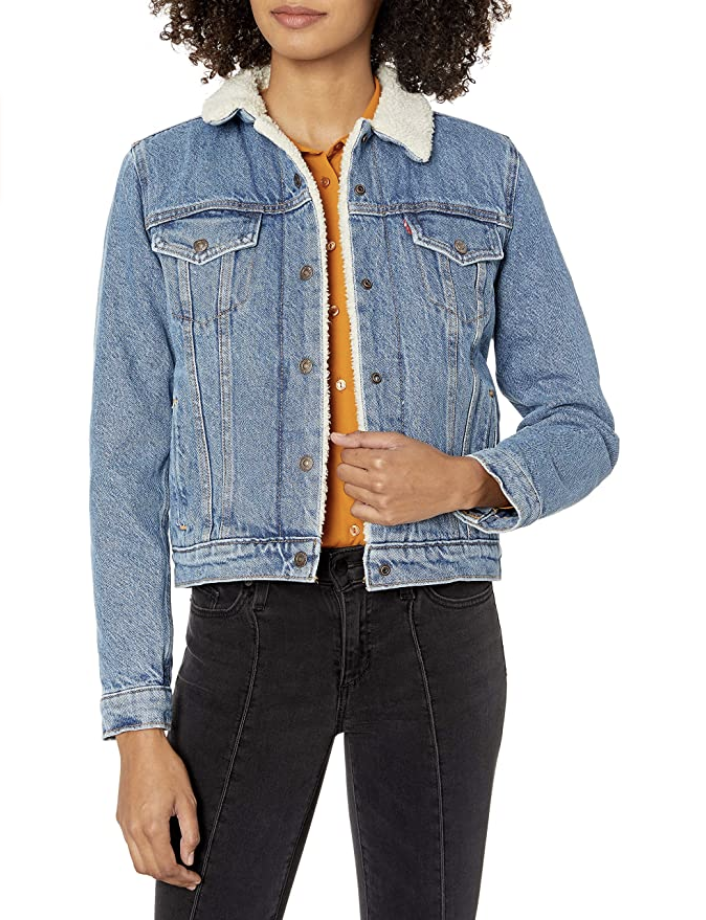 Model in denim jacket with sherpa lining