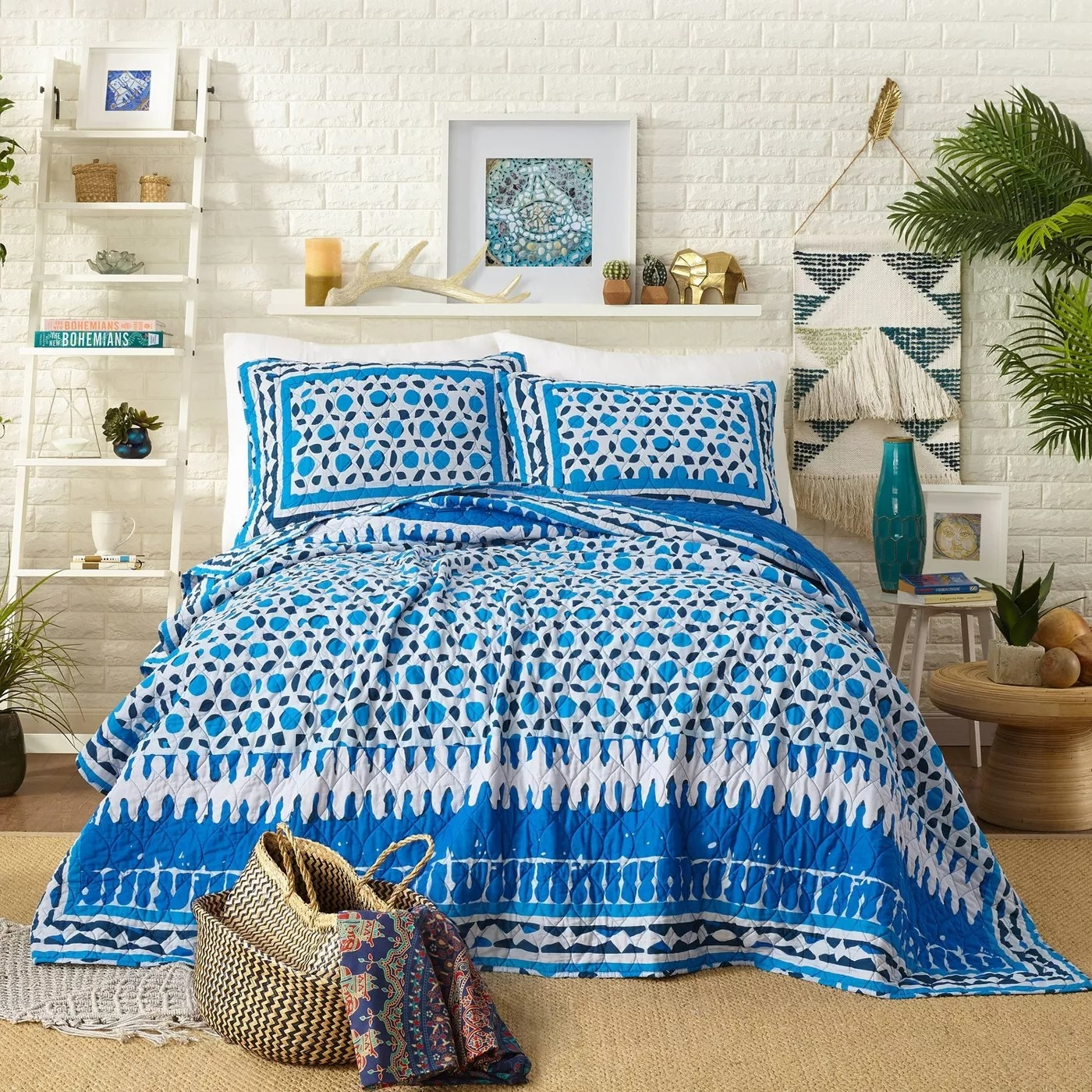 The blue, mosaic-inspired quilt and matching pair of shams