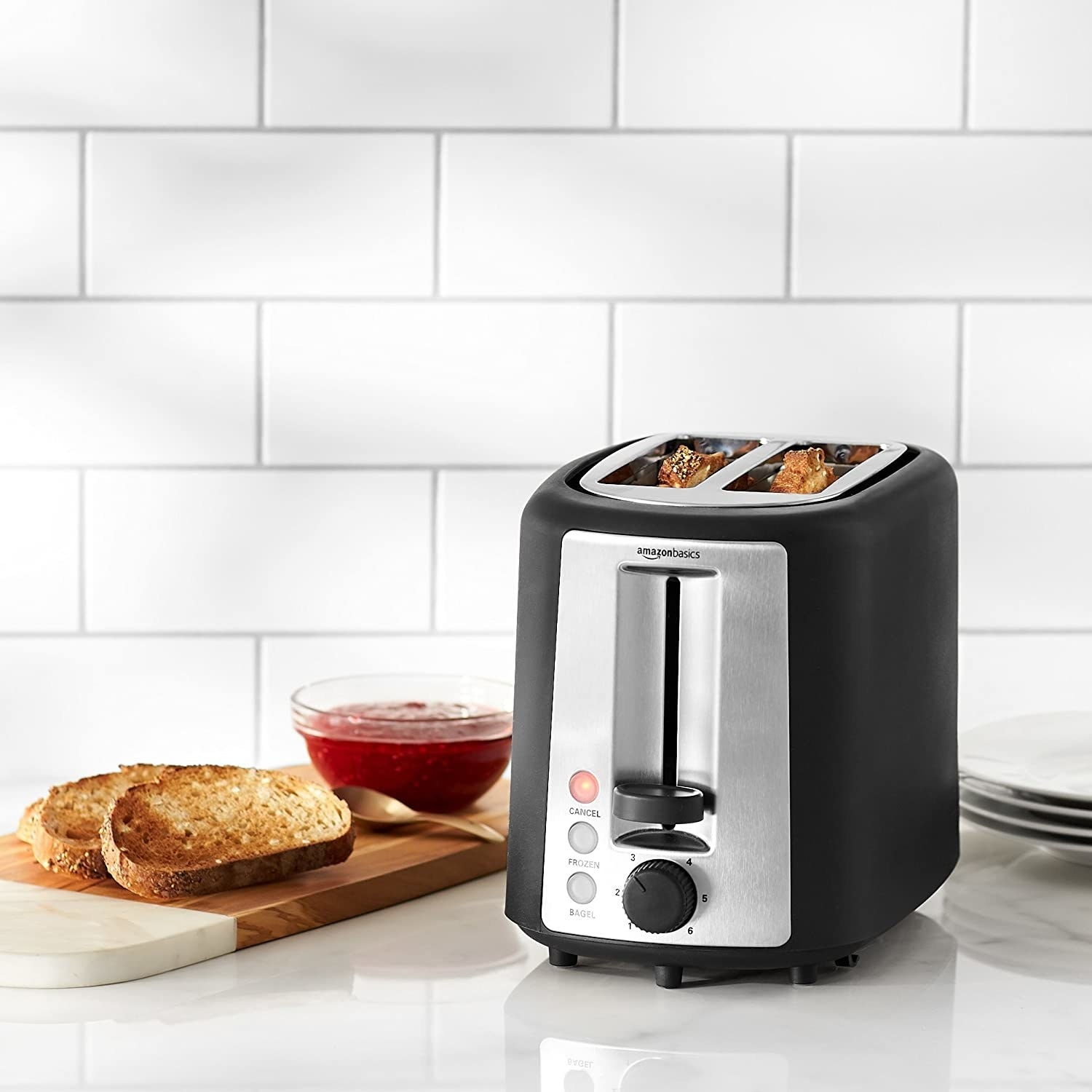 A toaster toasting bread on a kitchen counter