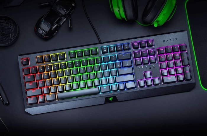 A light-up gaming keyboard on a desk