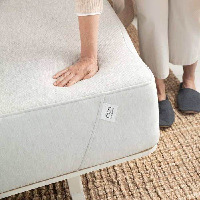 Model pressing into memory foam of mattress