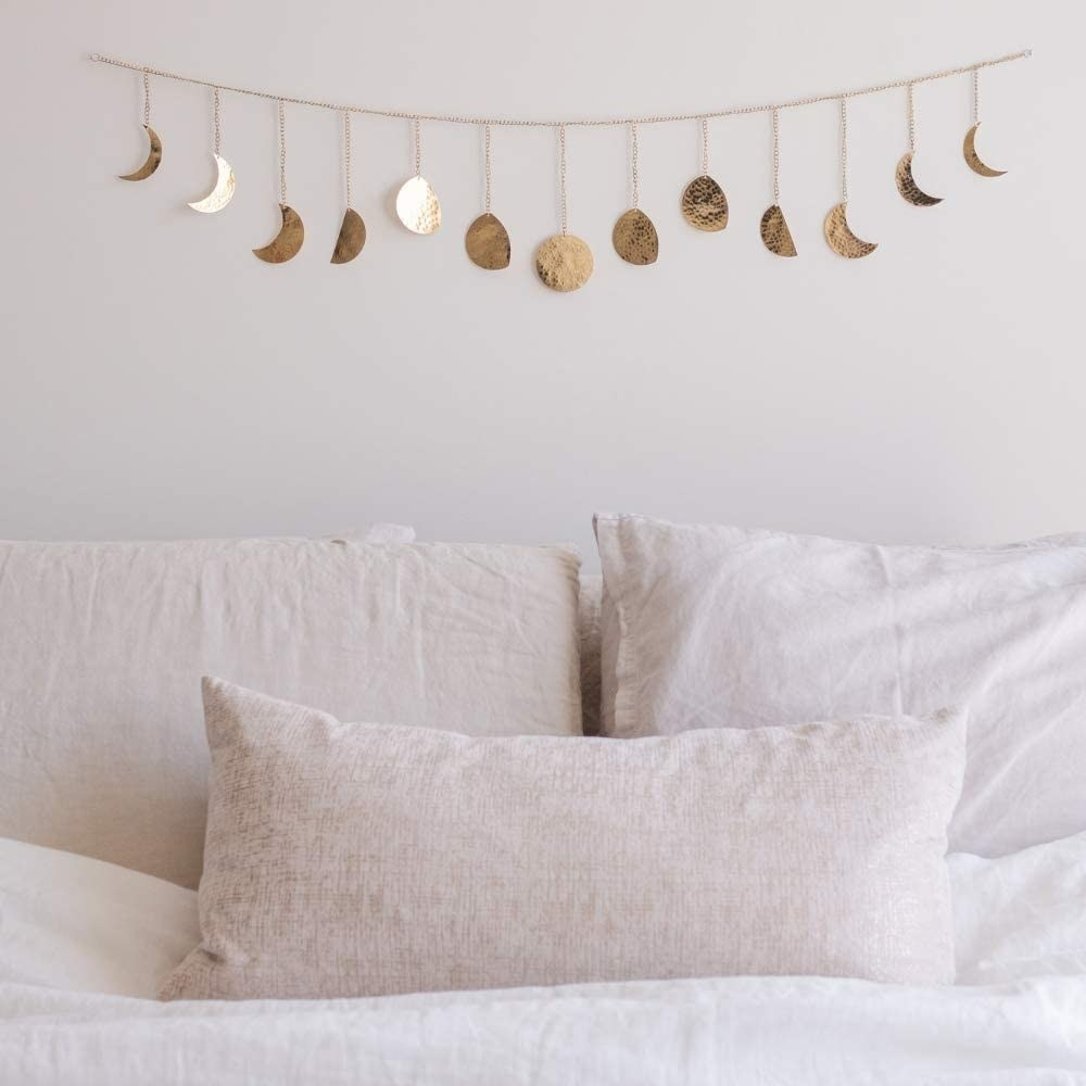 Metal garland with moon phase details