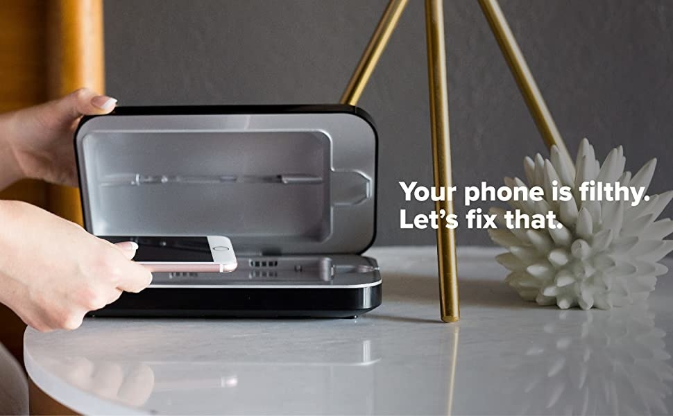 Phone being put into the compact rectangular PhoneSoap machine