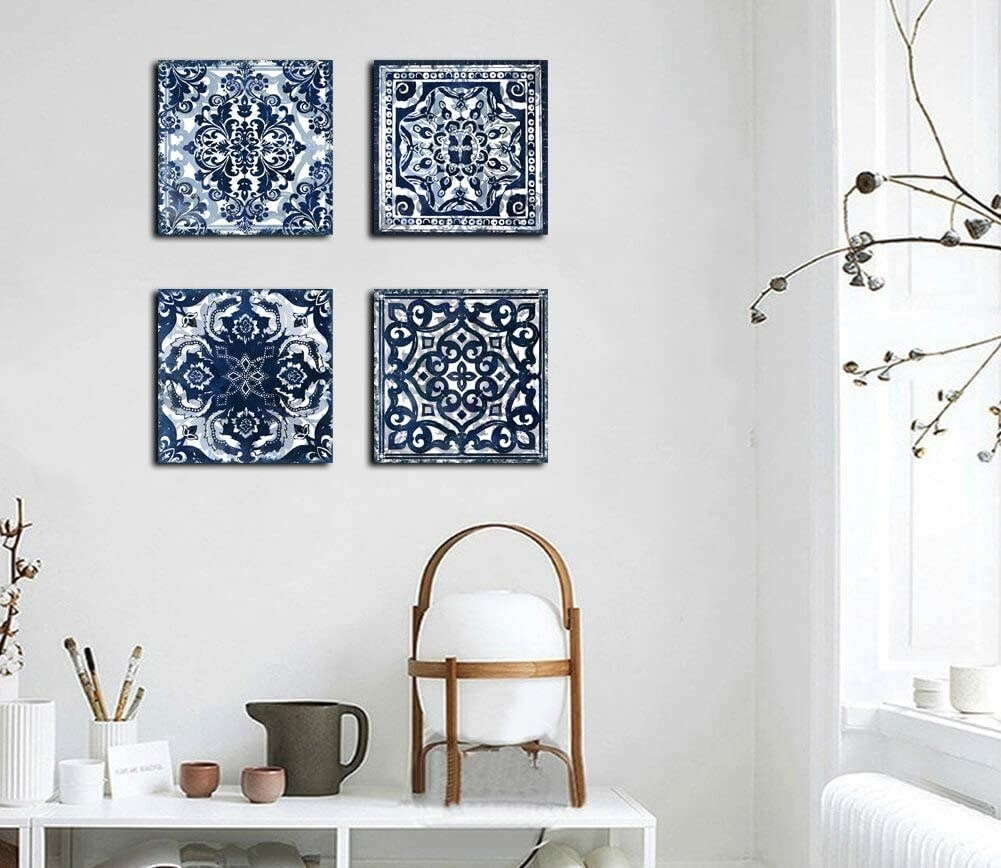 Four square canvases, each with different blue tile pattern
