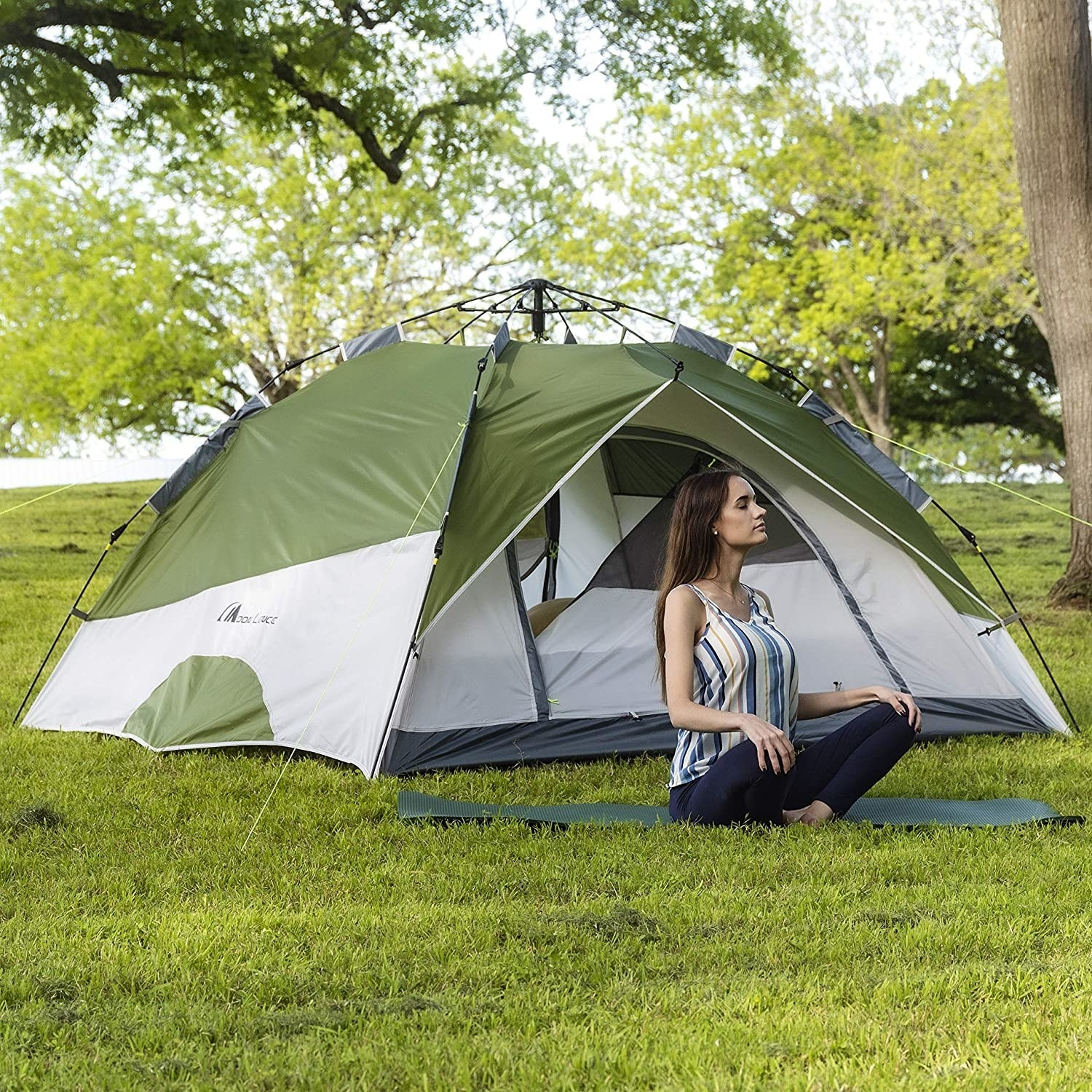 Person sitting outside large tent