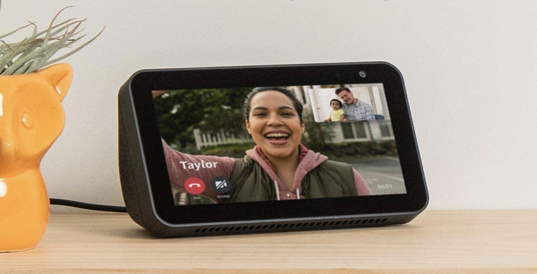 A person on the screen of an Amazon Echo Show 5 on a video call with their family from the other end