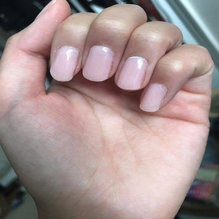 Reviewer with pale pink nails