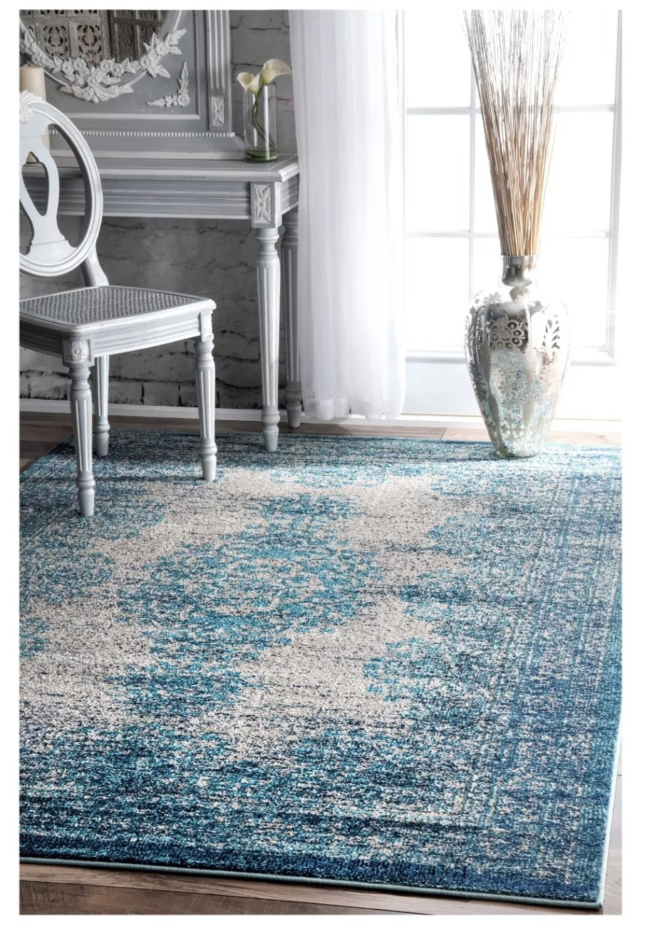 A blue vintage style rug in a living room