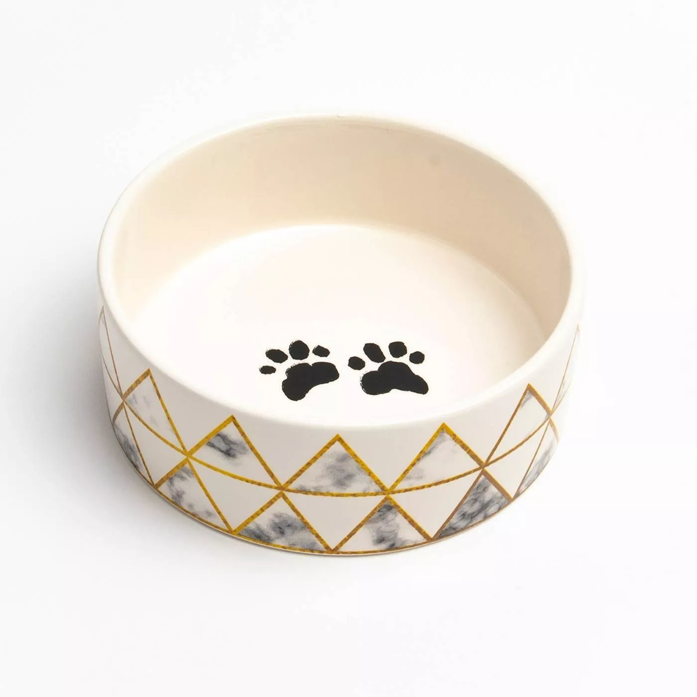 The dog bowl with marble diamond pattern and paw prints on the bowl