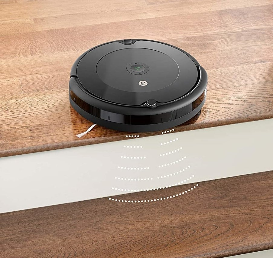 The robot vacuum at the top of a staircase