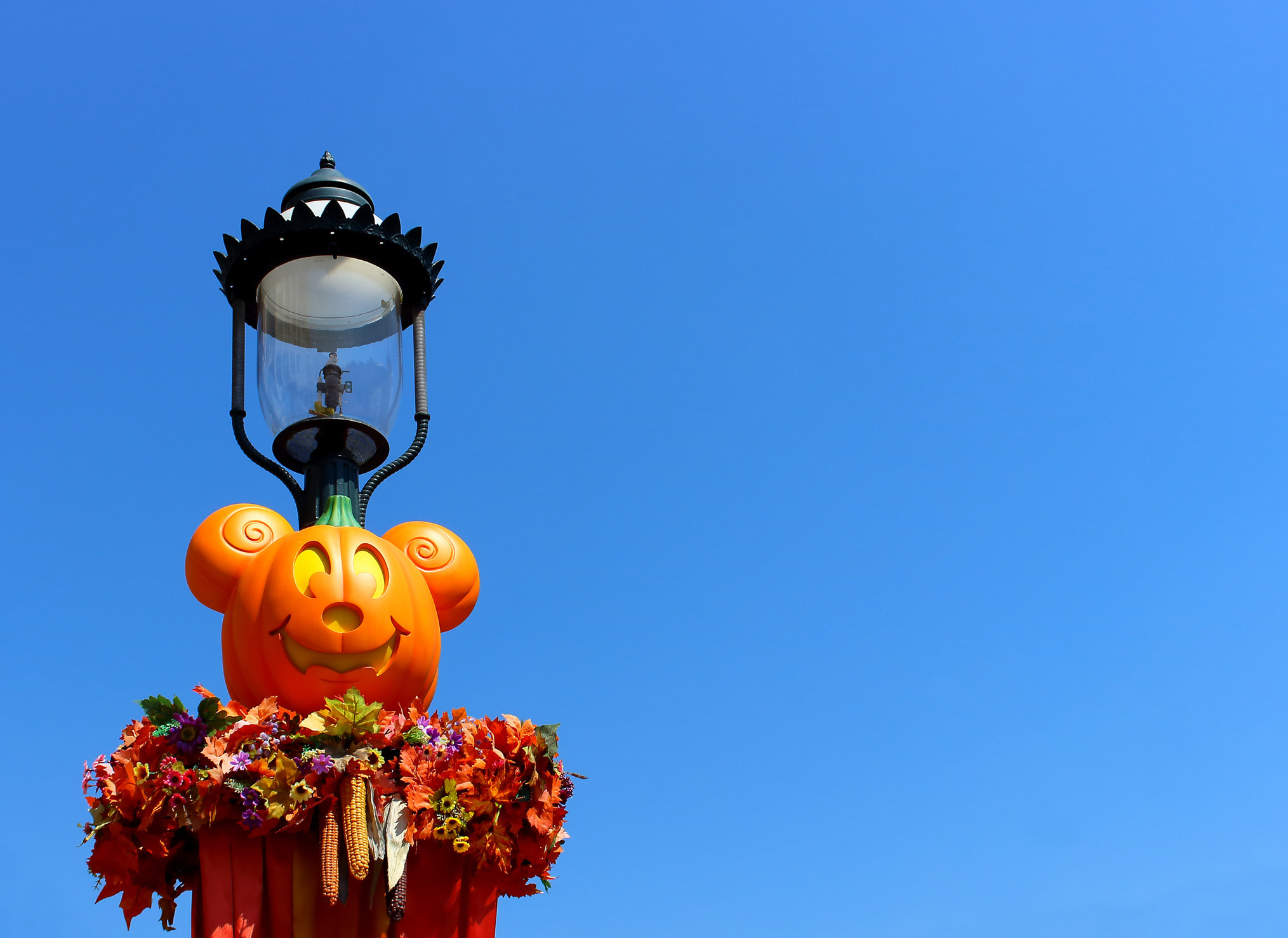 Image of pumpkin shaped as Disney's mickey mouse with a light on-top of the head of the pumpkin