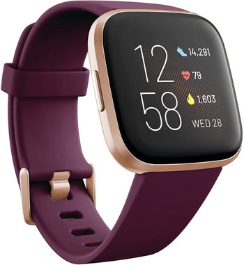 The watch with a square digital display and a purple band