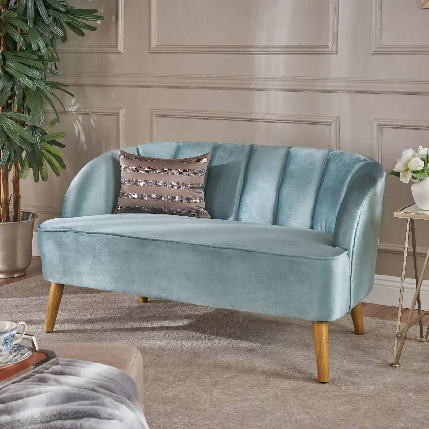 The velvet couch in seafoam blue