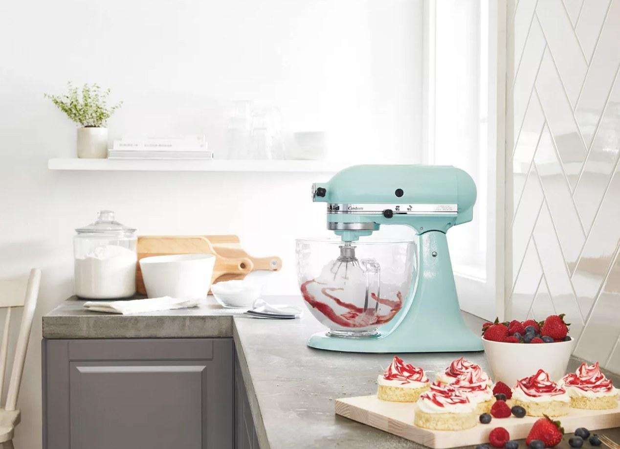 A light blue KitchenAid mixer in a kitchen