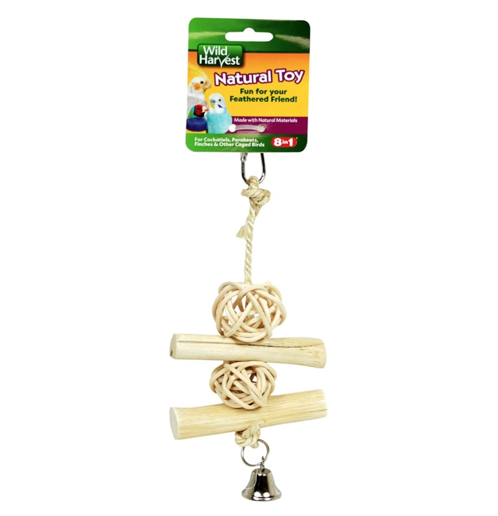 A beige dangling wood toy for birds