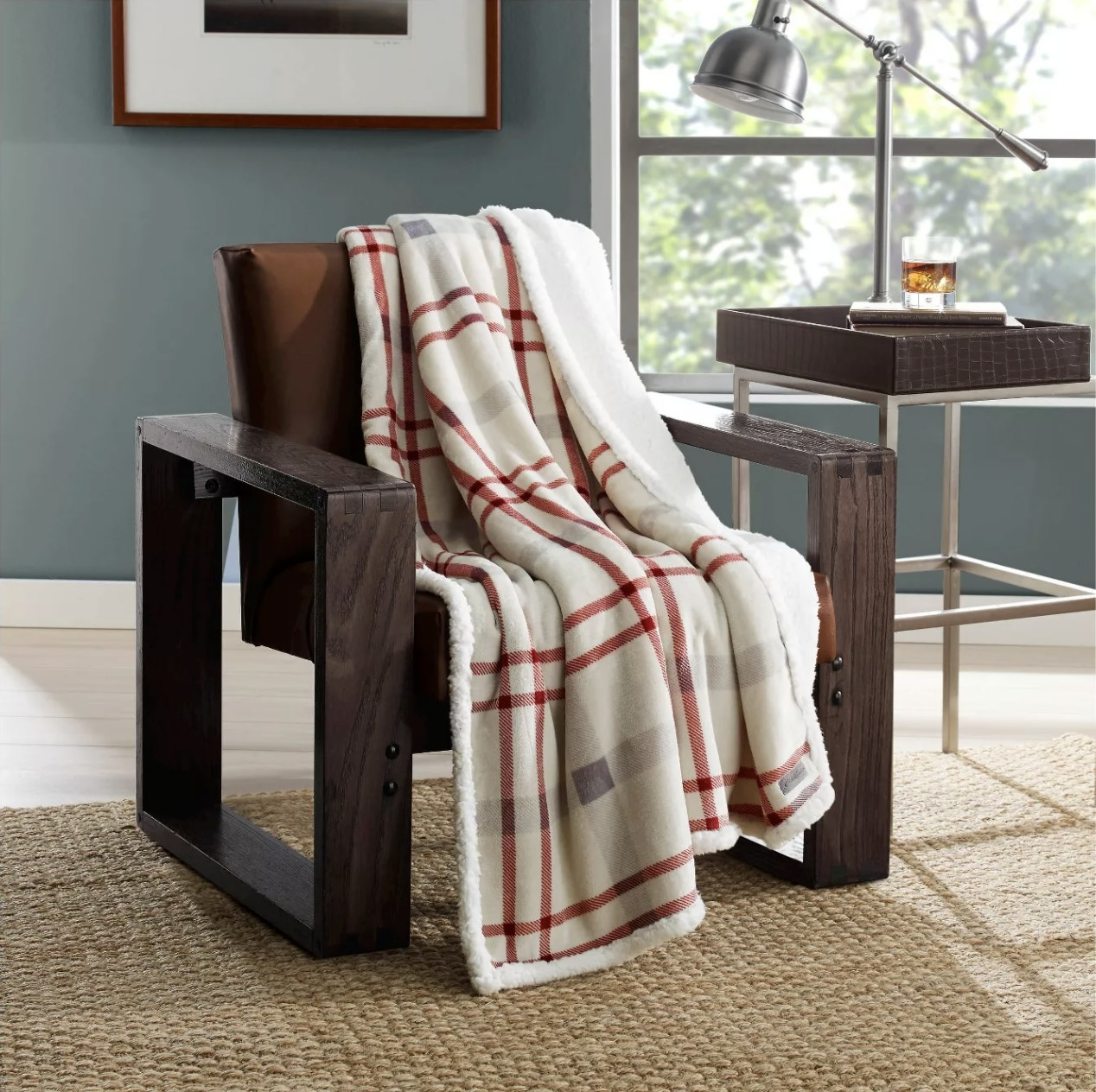 The white throw blanket with red flannel stripes on a chair
