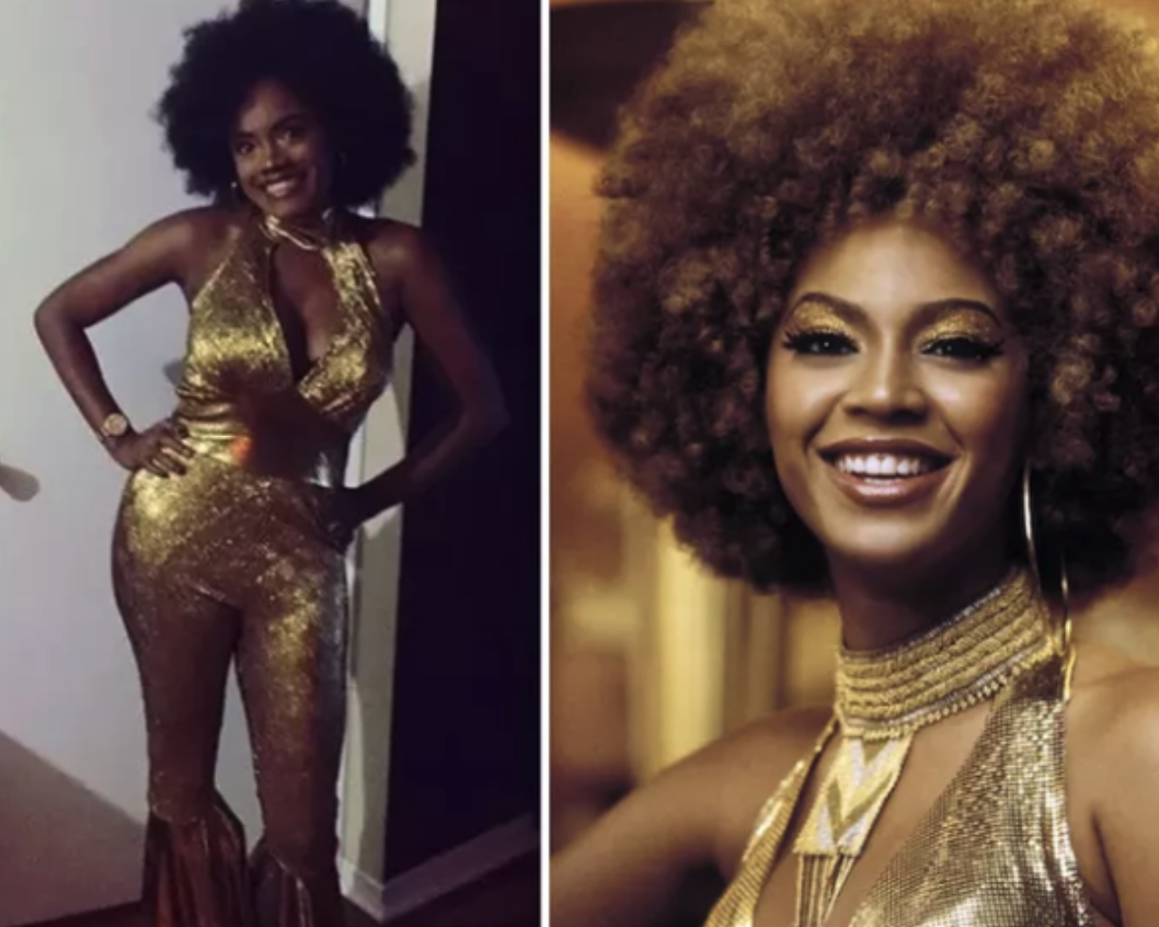 Someone dressed as Foxxy Cleopatra, with the iconic gold dress and Afro