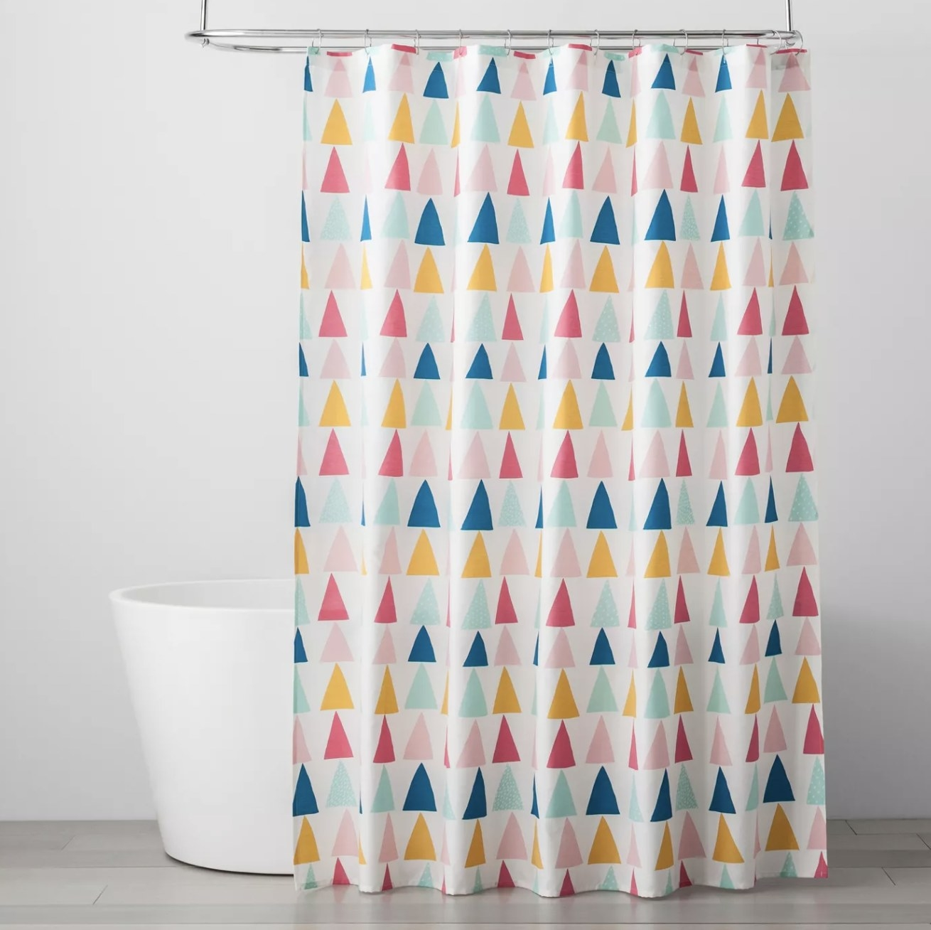 The shower curtain with colorful triangles throughout