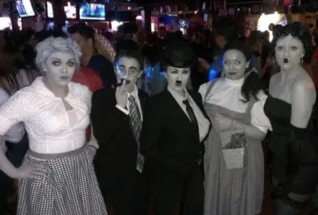 Five friends in black-and-white makeup to appear as Old Hollywood TV and movie characters