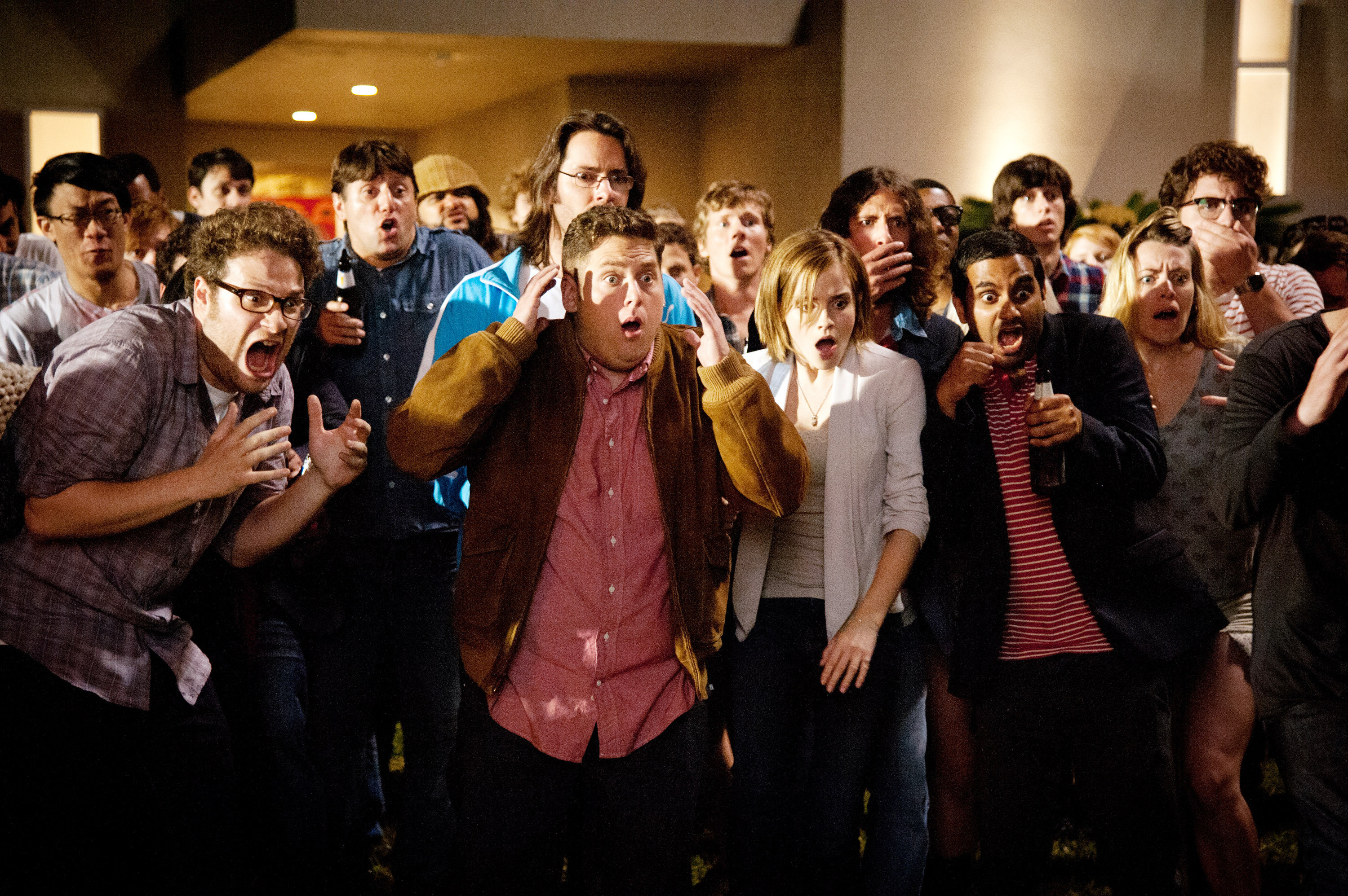 THIS IS THE END, foreground from left: Seth Rogen, Jonah Hill, Emma Watson, Aziz Ansari