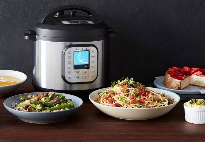 The Instant Pot beside yummy looking food
