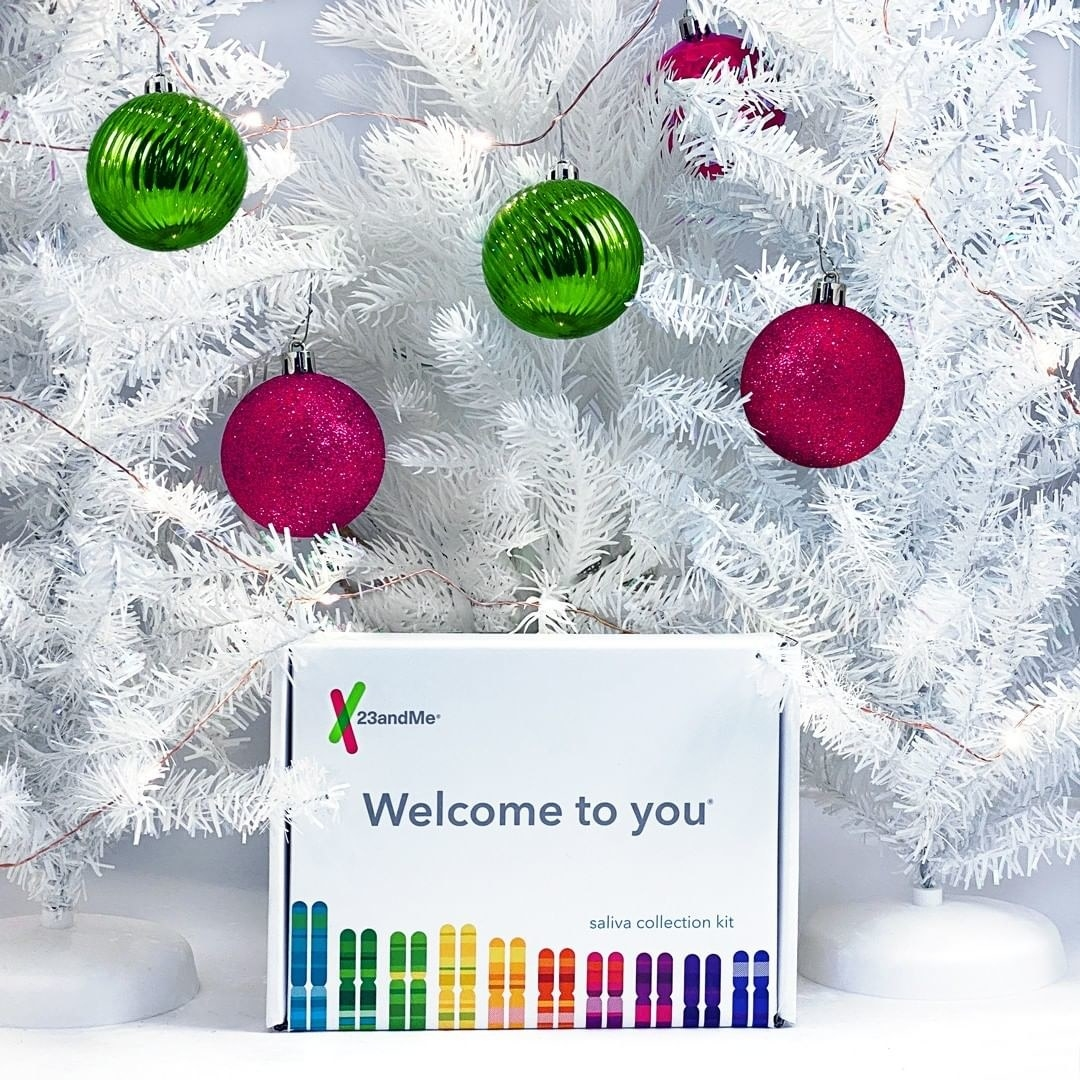 A DNA kit in a box underneath a Christmas tree